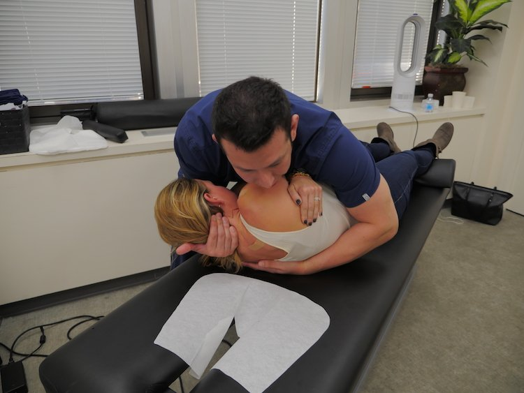 Patient receiving Osteopathic Manipulation adjustment